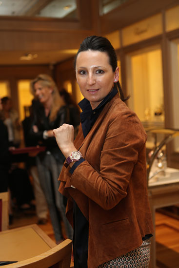 Silvia Olloqui wearing a Chopard mother of pearl watch covered in pink sapphires and diamonds