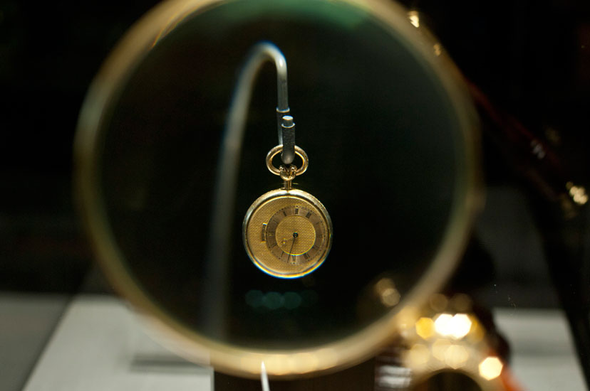Breguet #5038 owned by Count A. Demidov in 1832. Tiny simple watch made on chronometer principles, gold case, off-centre gold dial, lever escapement, platinum balance wheel, winding and time-set crown on pendant. 18mm diameter.