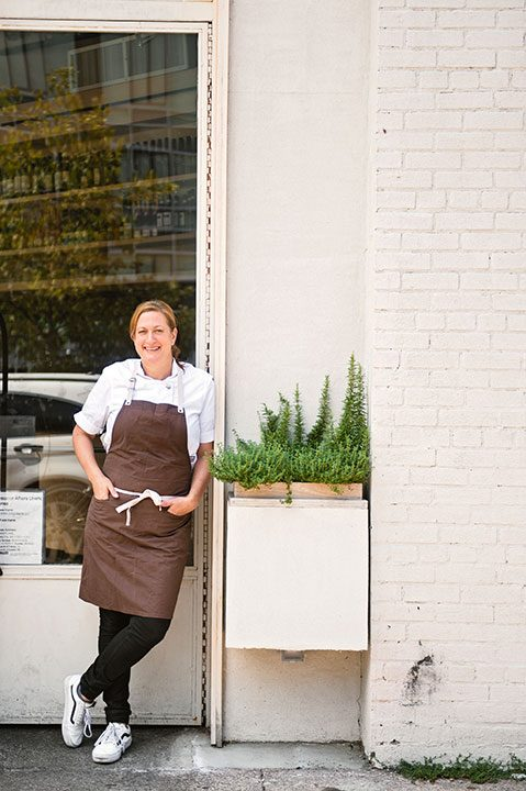 Acclaimed chef Missy Robbins standing outside of her Brooklyn restaurant, Lilia.