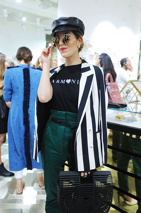 Fashion influencer and stylist Gabriela Medina sporting Linda Farrow's Round sunglasses.