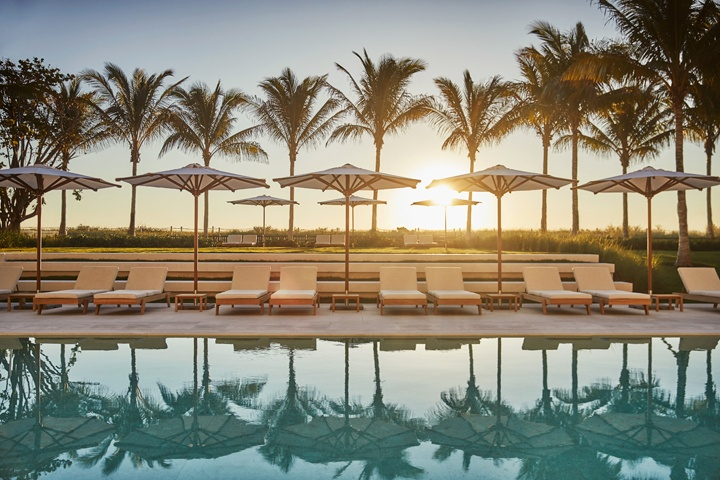 The pool at the Four Seasons at The Surf Club calls for a moment of reflection—and relaxation.