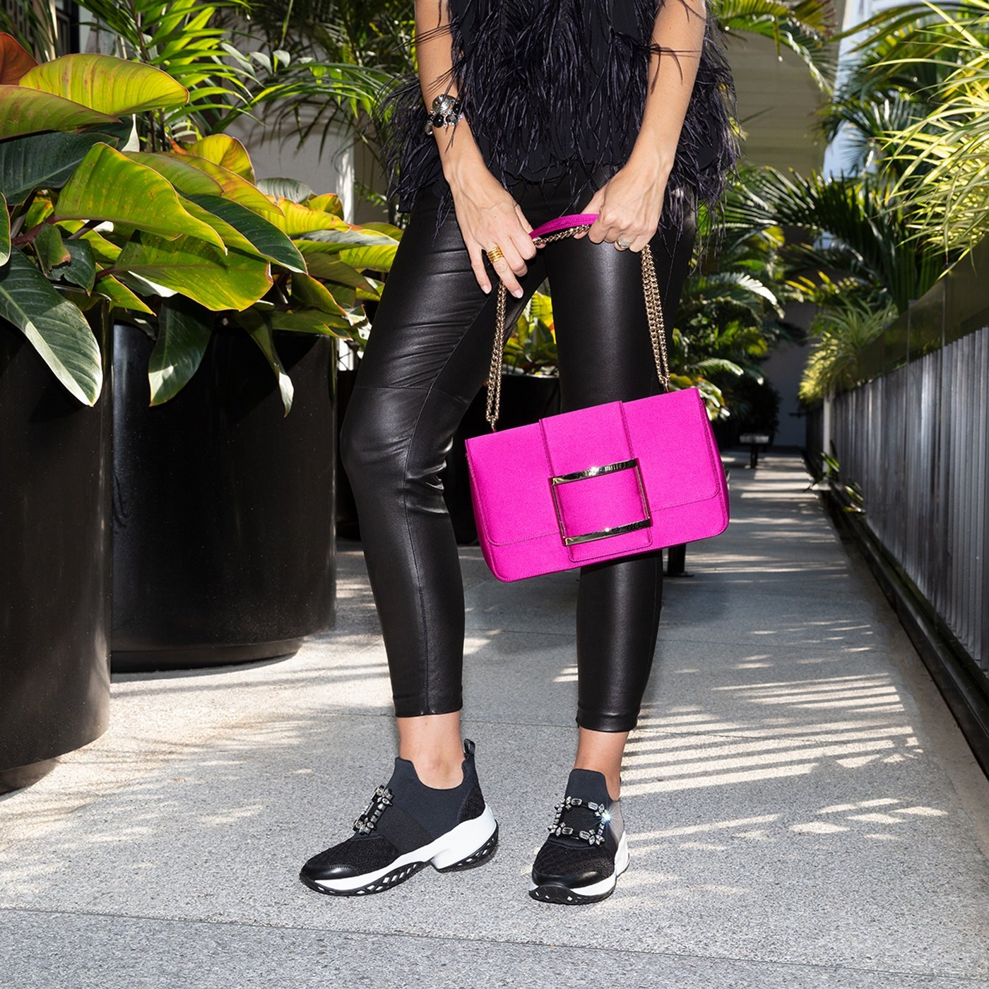 Très Vivier bag and Viv' Run Strass Buckle Sneakers are available at Roger Vivier Bal Harbour.