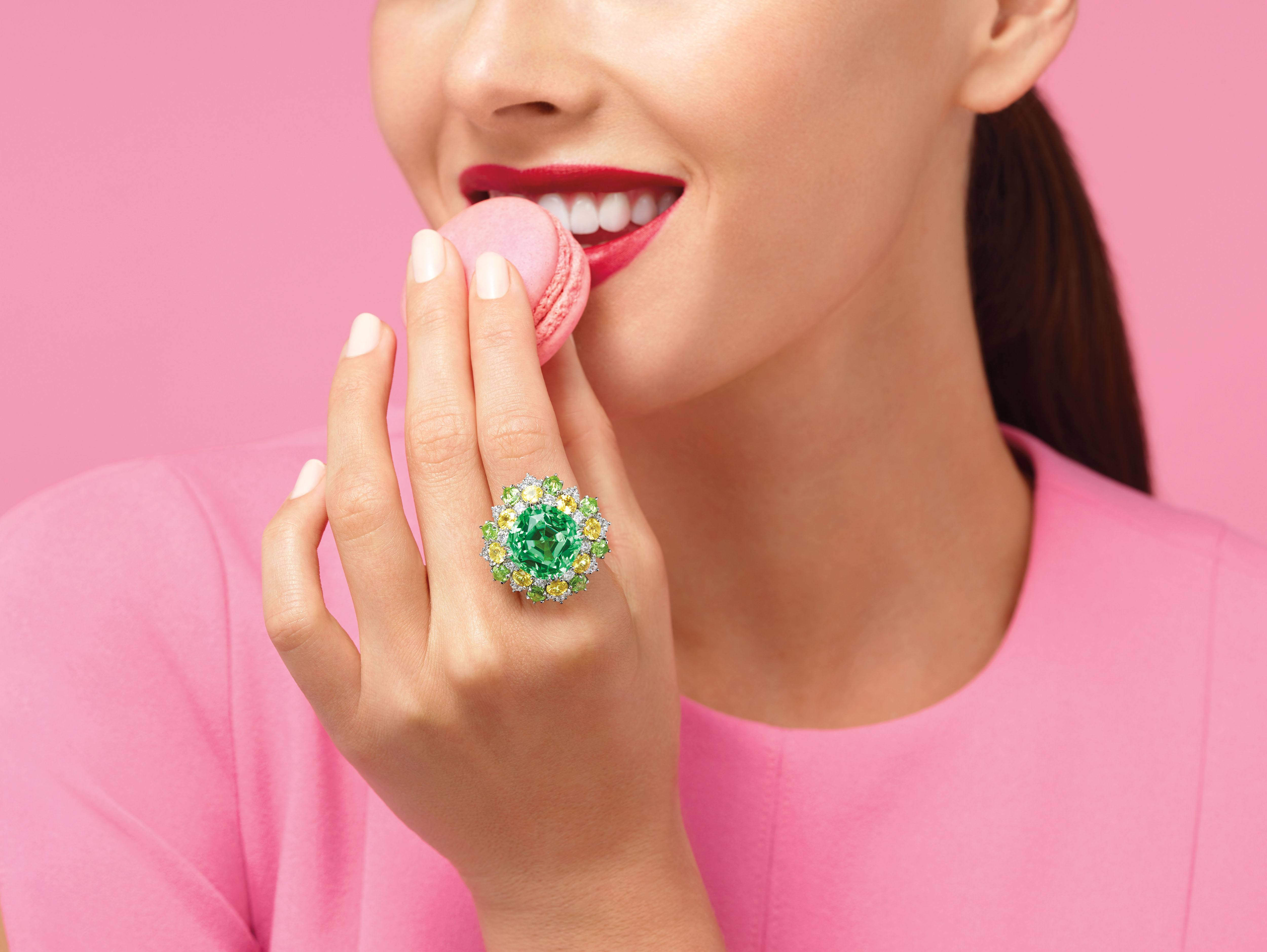Model wearing the limited edition Harry Winston Green Tourmaline Ring with Yellow Sapphires, Peridots and Diamonds from the Candy Collection