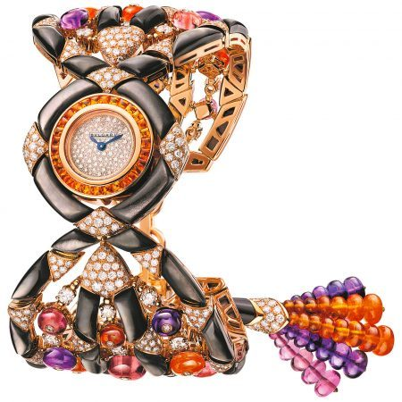 Gemma Bulgari watch with 18 kt rose gold case set with buff-cut spessartite, brilliant cut-diamonds and black mother-of-pearl elements, snow pavé dial, 18 kt rose gold bracelet set with tourmaline, spessartite and amethyst beads, black mother-of-pearl elements and brilliant-cut diamonds