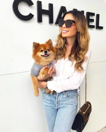 Influencer Jasmine Tosh in front of Chanel Bal Harbour with her pup