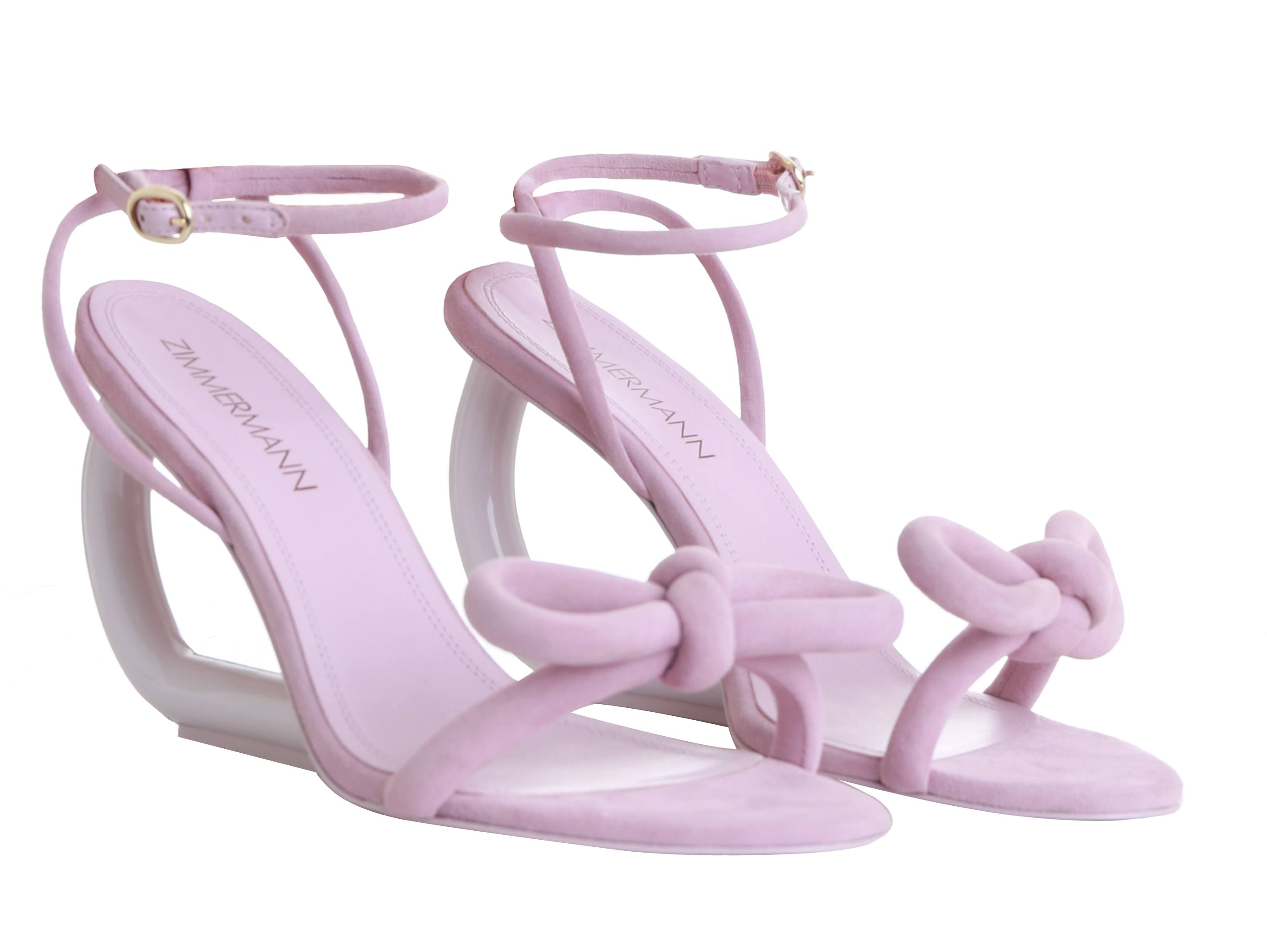 Zimmermann light pink bow sandal with bow tie accessory and strap