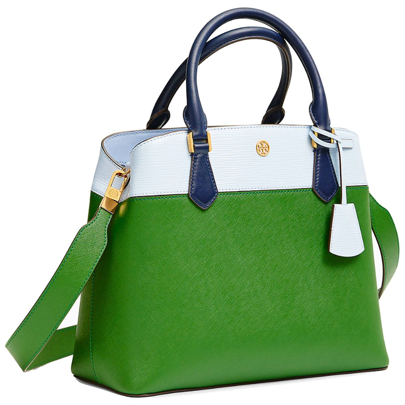 The triple-compartment Tory Burch Robsinson tote is made from color-blocked leather, with gently curved lines, it's ultra-functional — with a pocket for every essential — and detailed with a logo charm and an optional strap