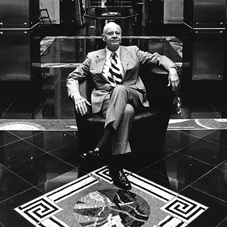 Black and white image of retail visionary and creator of Bal Harbour Shops Stanley Whitman inside Versace Bal Harbour in 1991