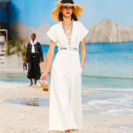 A runway look in a white jumpsuit from Chanel's Spring 2019 runway