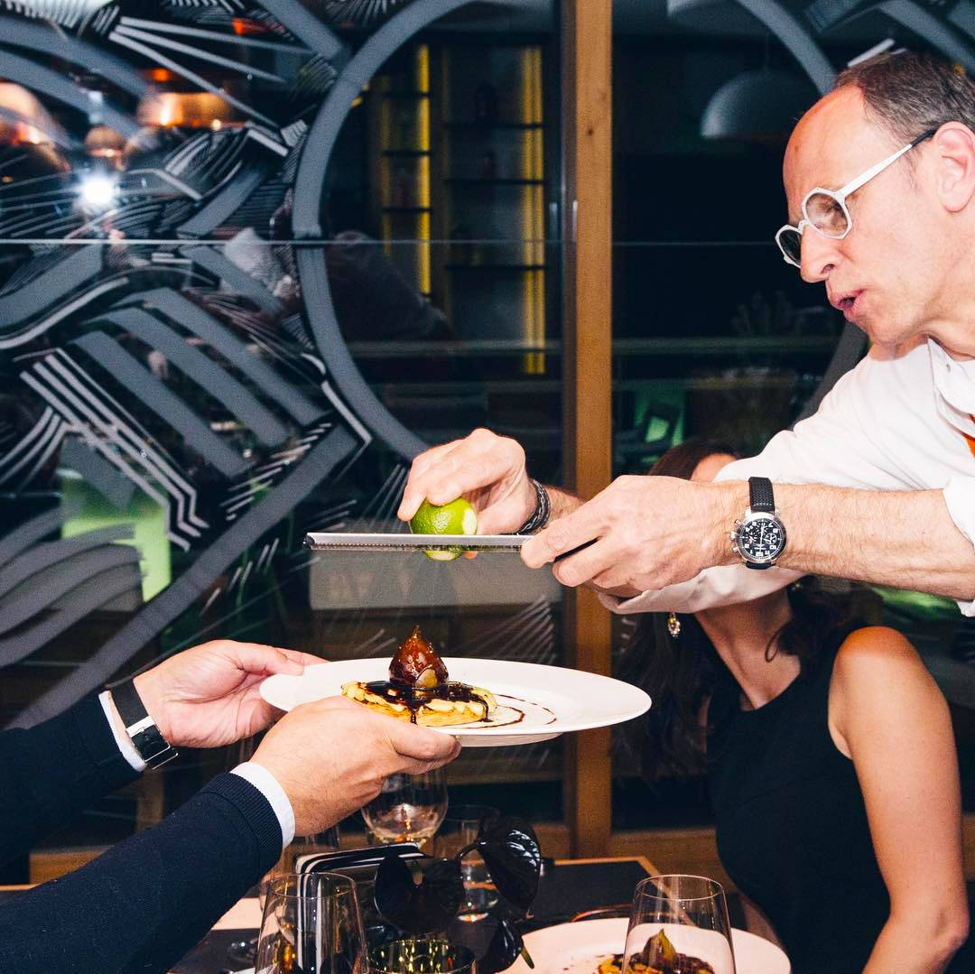 Michelin star chef Joel Cesari grating lime onto one of his signature dishes