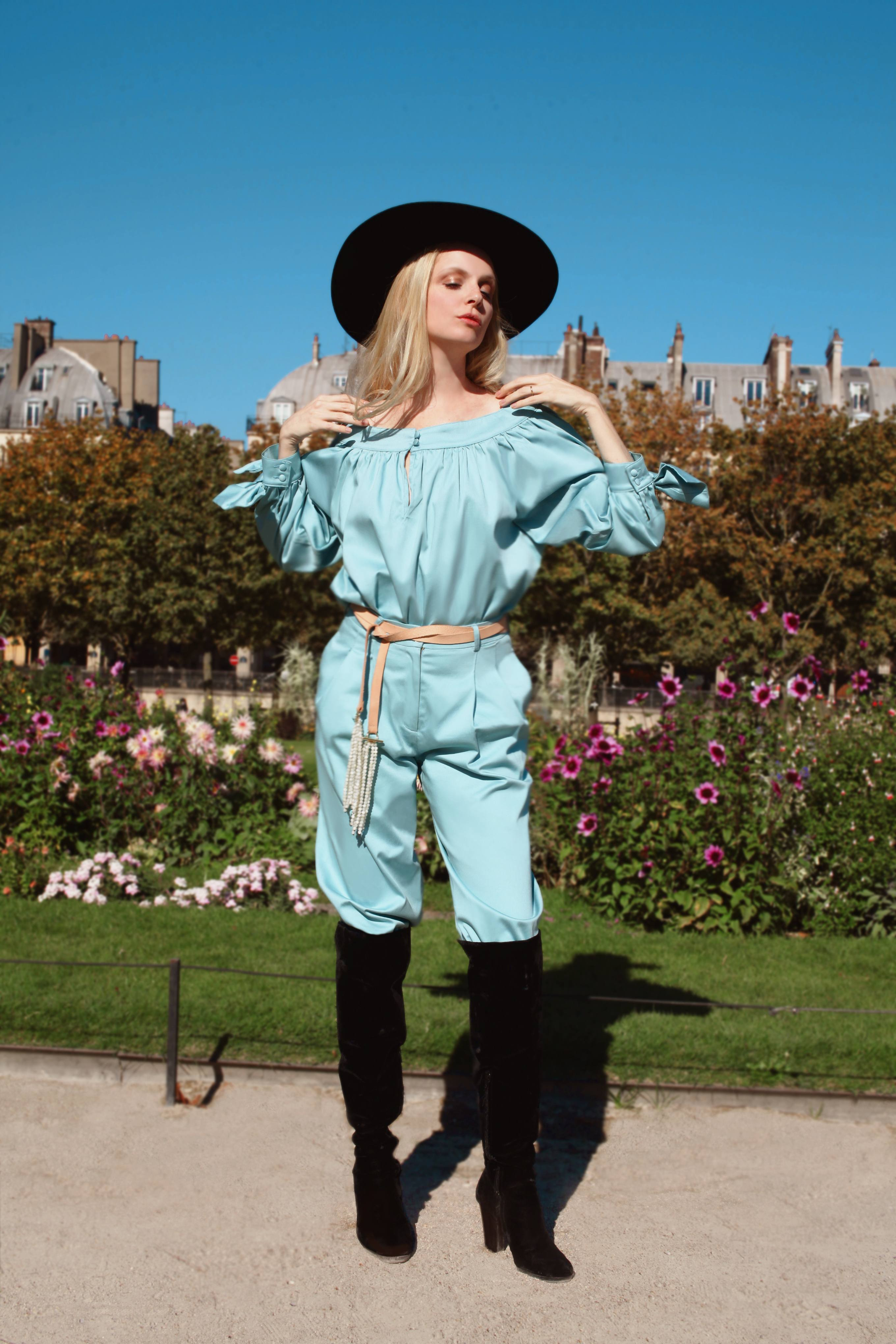 Sofia Achaval De Montaigu wearing Desnuda top in Light Blue Cotton Satin paired with Al Boleo pants in Light Blue Cotton Satin and styled with the Tientos belt
