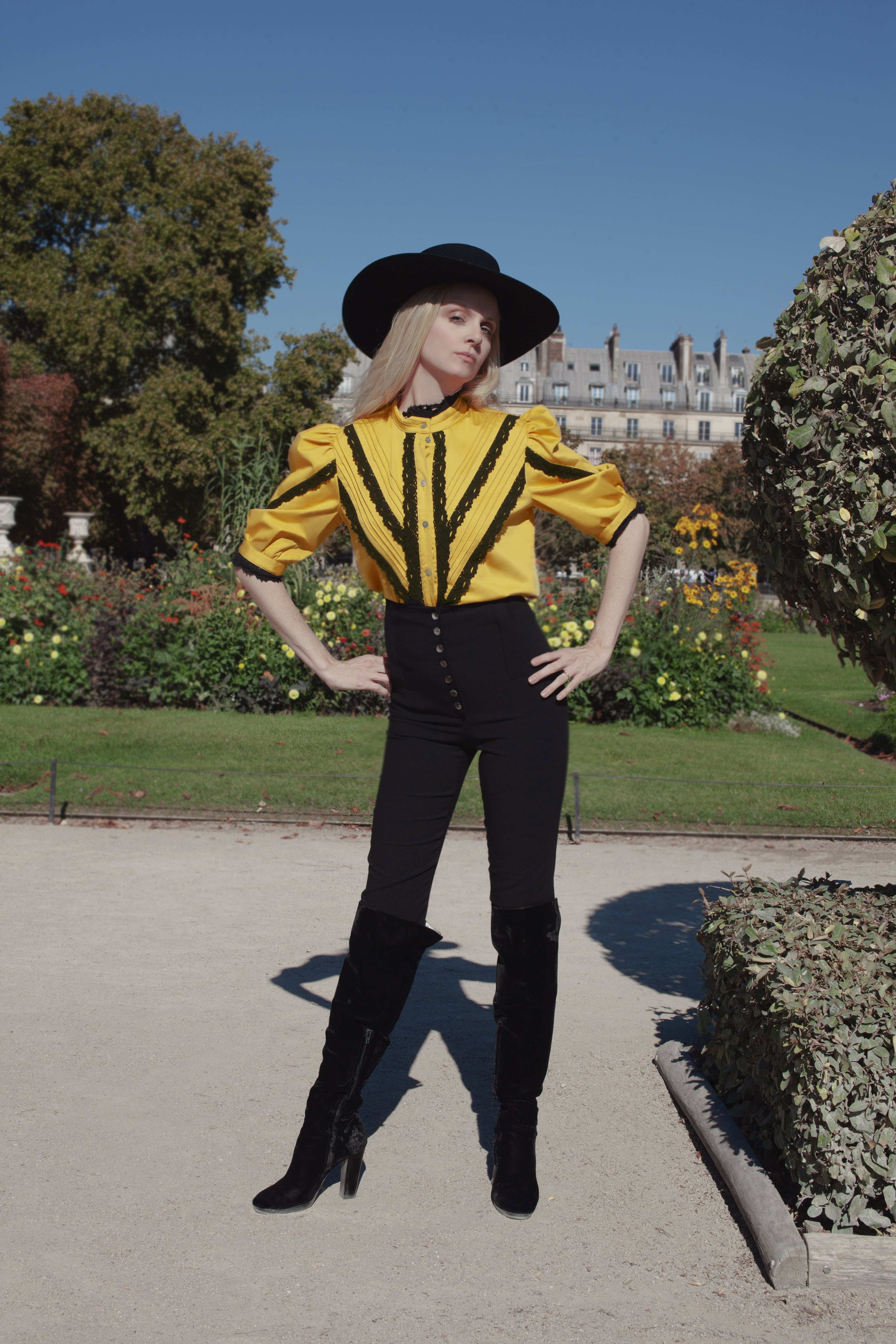 Sofia Achaval De Montaigu wearing Yegua Shirt in Yellow Cotton Satin paired with Palo pants in Black Cotton Satin and styled with the Gaucho Hat
