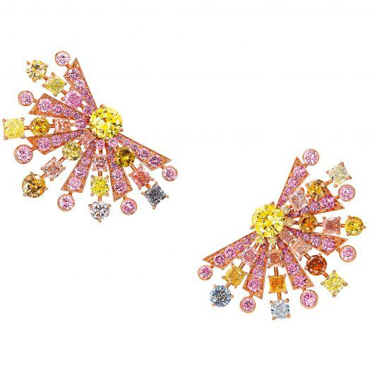 Radiating outwards from two round Fancy Vivid Yellow diamonds, these fabulous fan shape earrings feature rows of multi-coloured round and cushion cut diamonds totalling more than 27 carats in a captivating array of hues