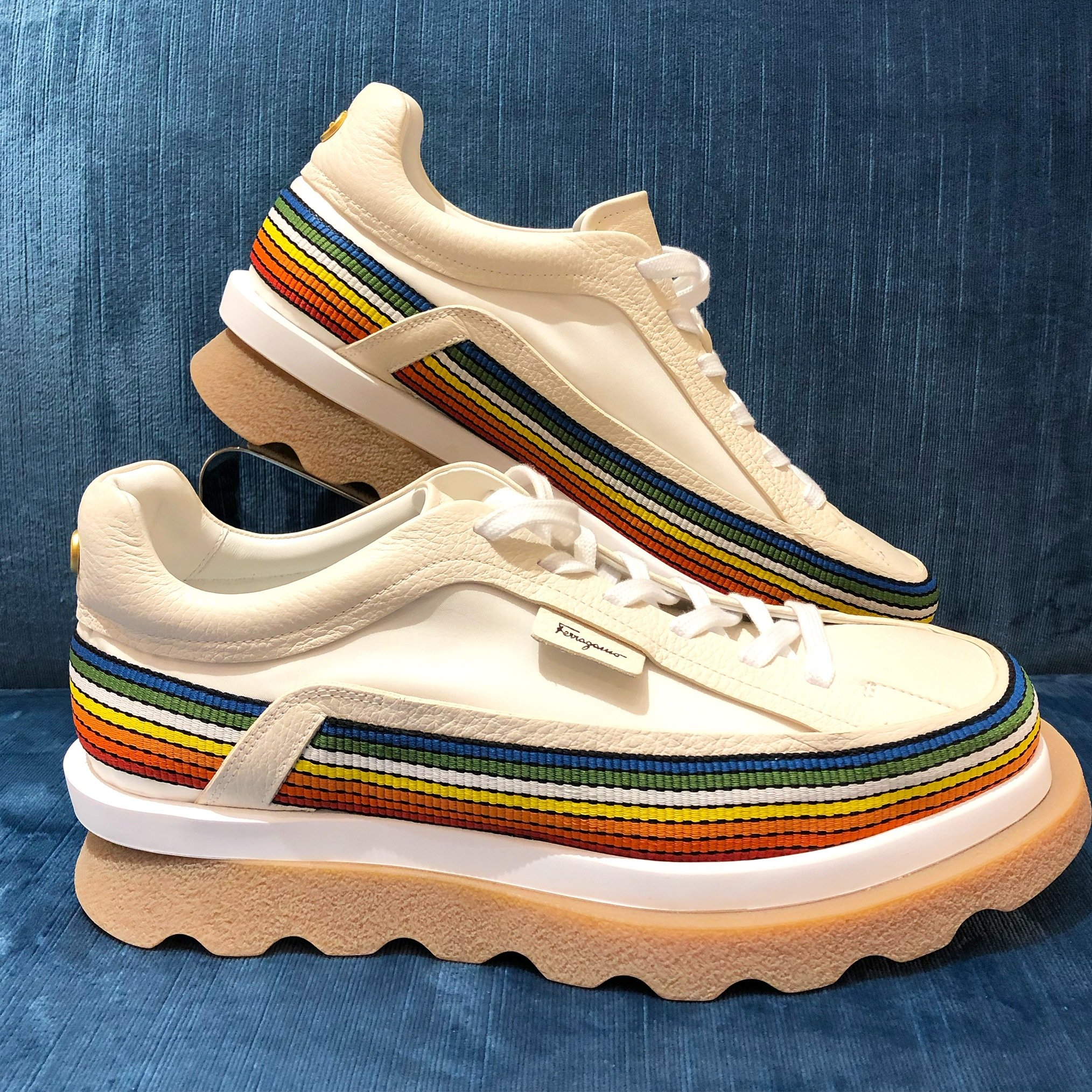Salvatore Ferragamo Sustainable Thinking Sneaker is set on a thick rubber sole, they are adorned with rainbow pattern