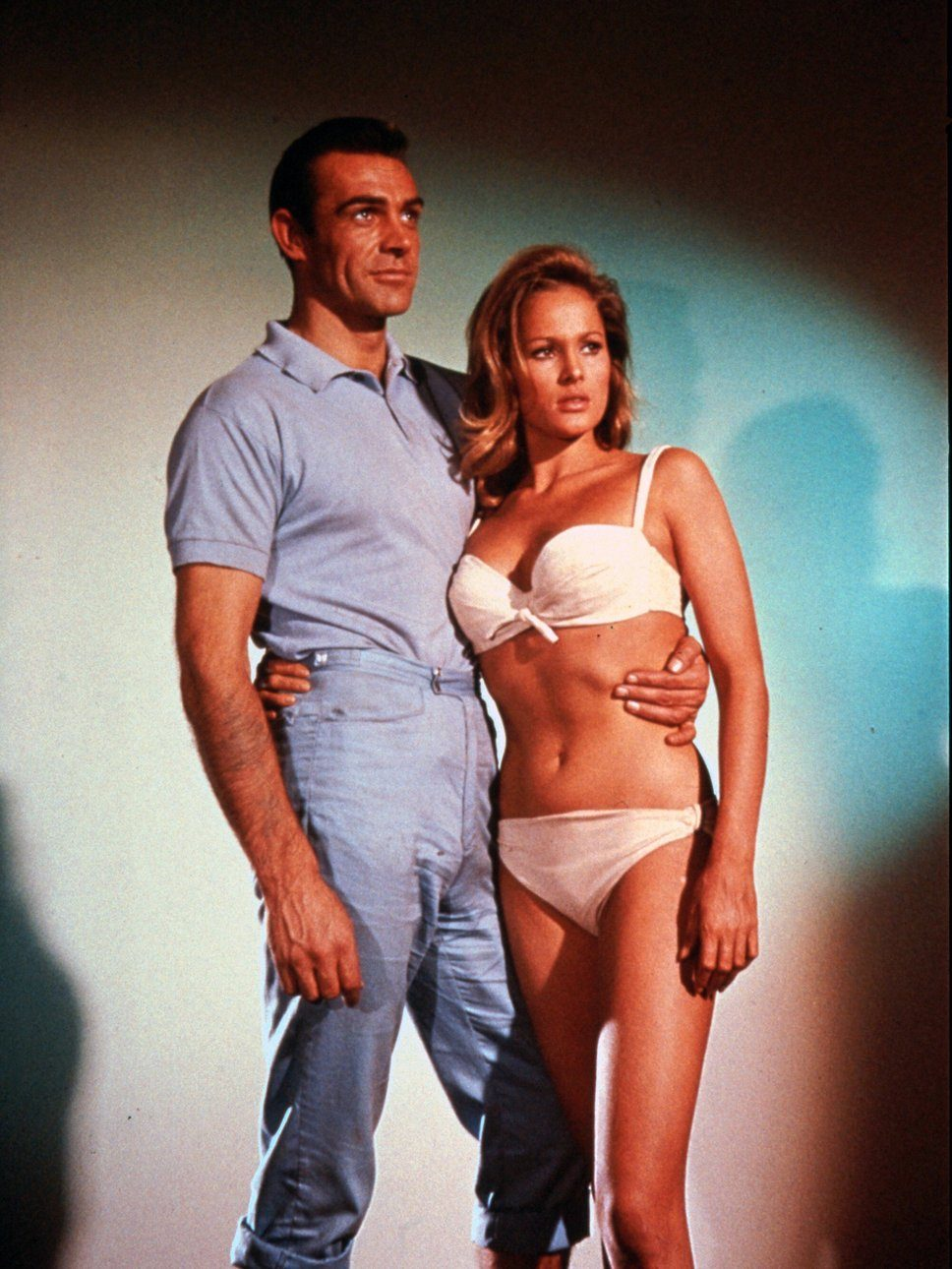 Actor Sean Connery as James Bond posing with actress Ursula Andress as Honey Ryder in the first James Bond film, Dr. No