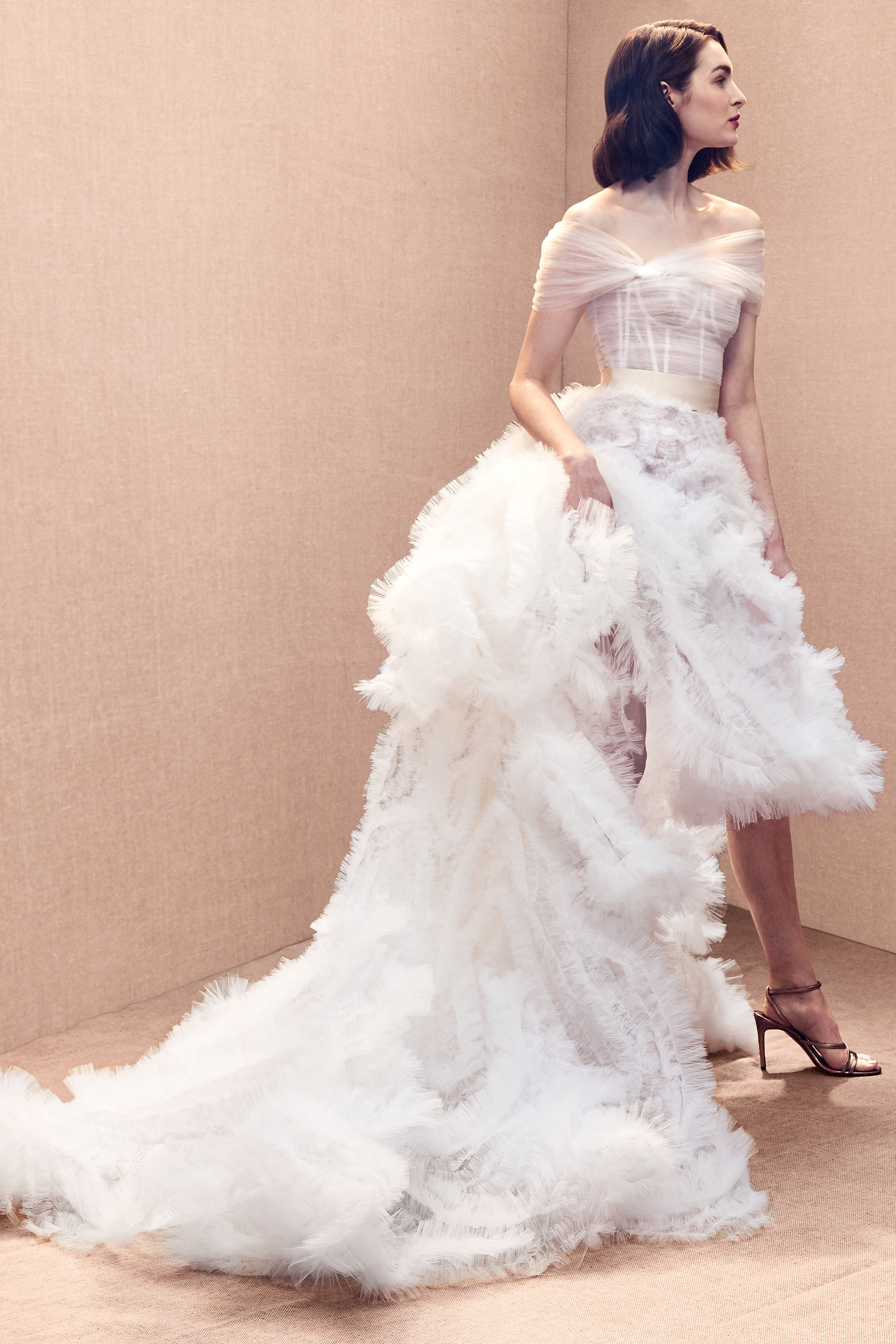 Off-the-shoulder bustier ballgown with embroidered tulle skirt.