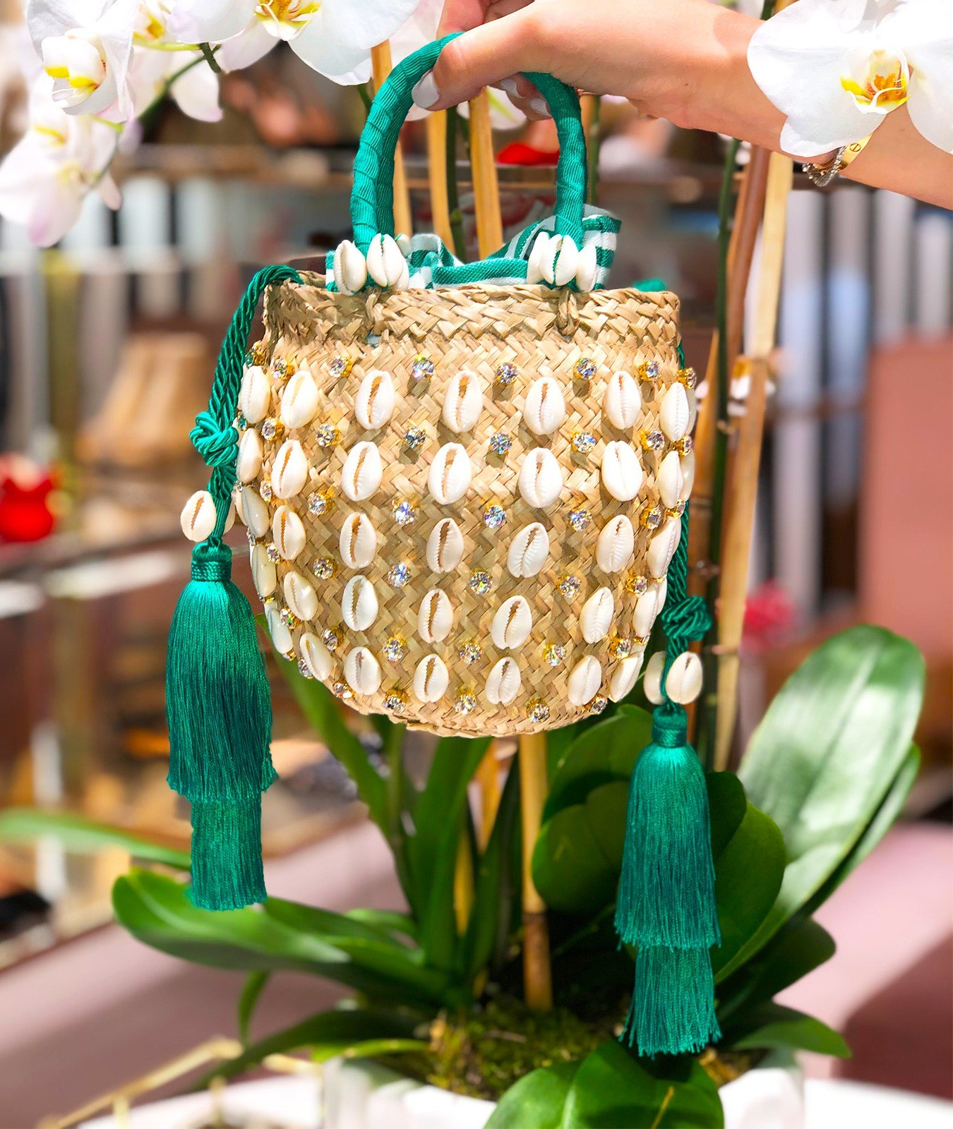 The Aquazzura Riviera bag is one of the styles created in collaboration with Le Ninè for the Escapes Capsule Collection. Hand-crafted from natural raffia, embellished with tropical cowrie shells, eye-catching crystals and swingy tassel