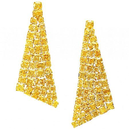 The striking, simple and contemporary silhouette of these Graff yellow diamond earrings places the stones as the heroes of the piece; their effervescent hue complemented by an almost invisible yellow gold setting