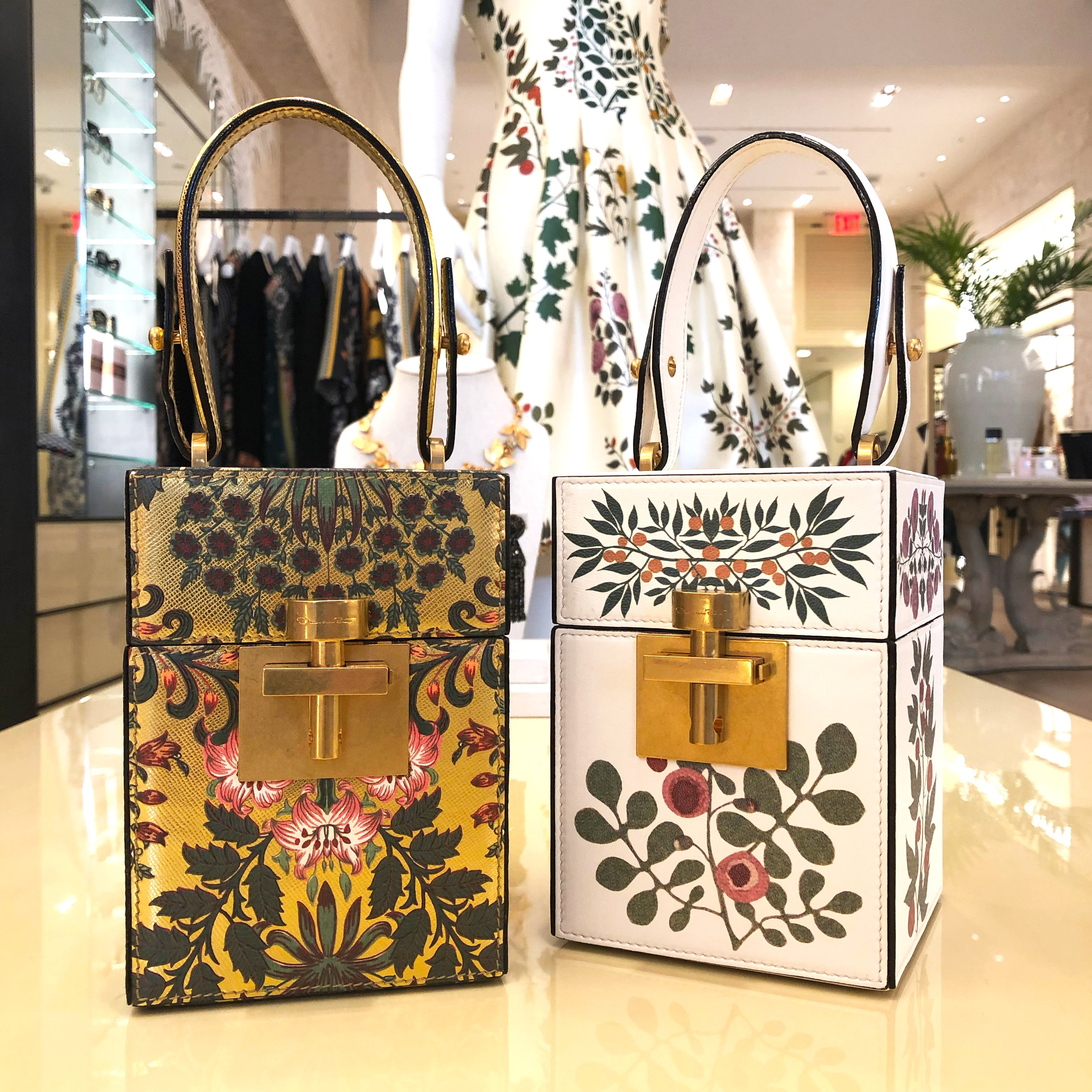 Oscar de la Renta Mini Alibi Bag inspired by vintage travel trunks, the Alibi bag is crafted from printed gold leather and printed shell leather with a lock clasp and a tonal top handle