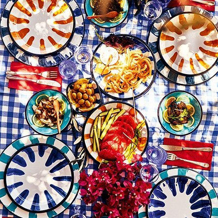 A vibrant spread of fresh olives, tomatoes, and mezes for the voyagers at the Bozburun Yacht Club
