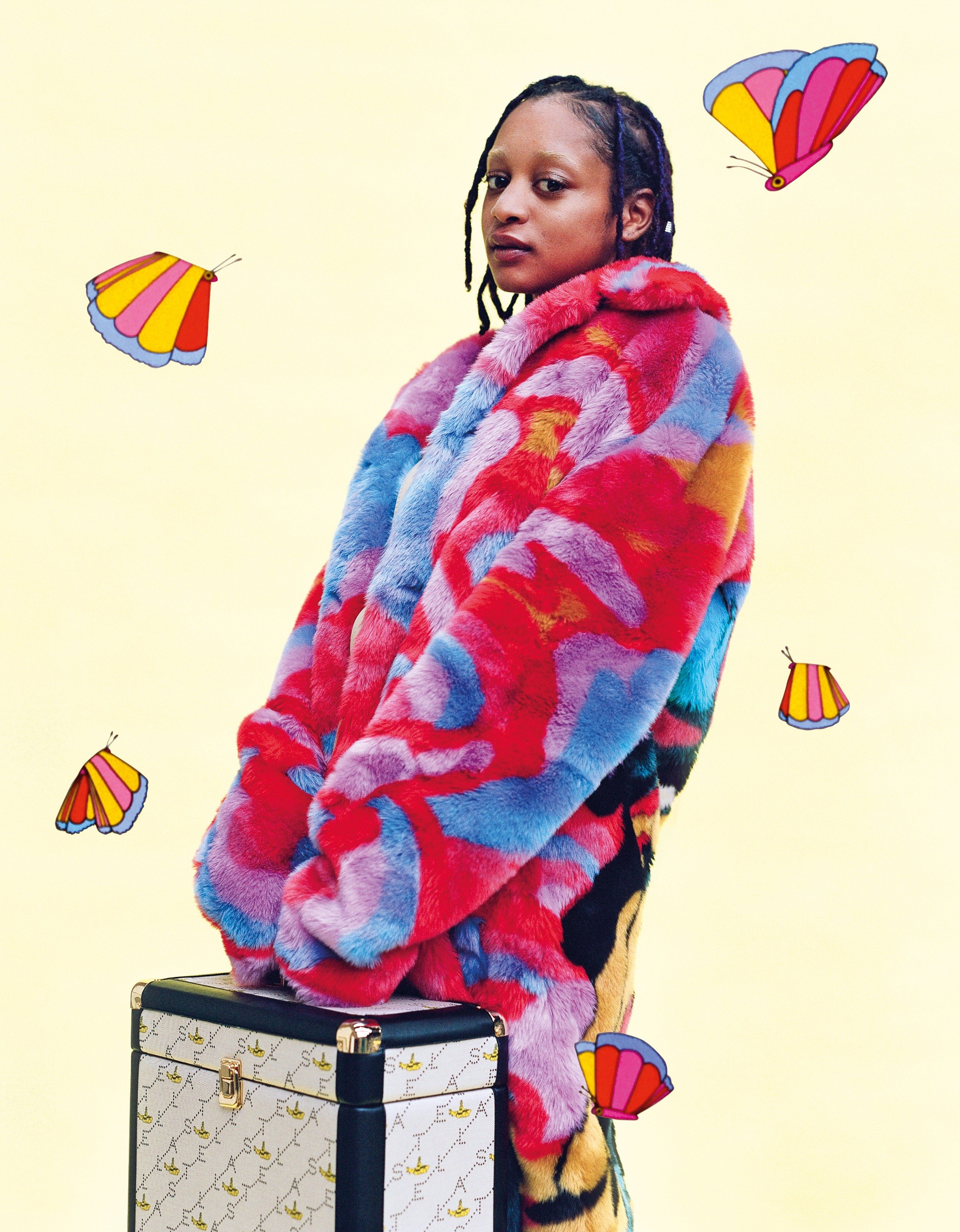 Fur Free Fur 'All Together Now' coat as seen on musical talent KEYAH/BLU from South London.