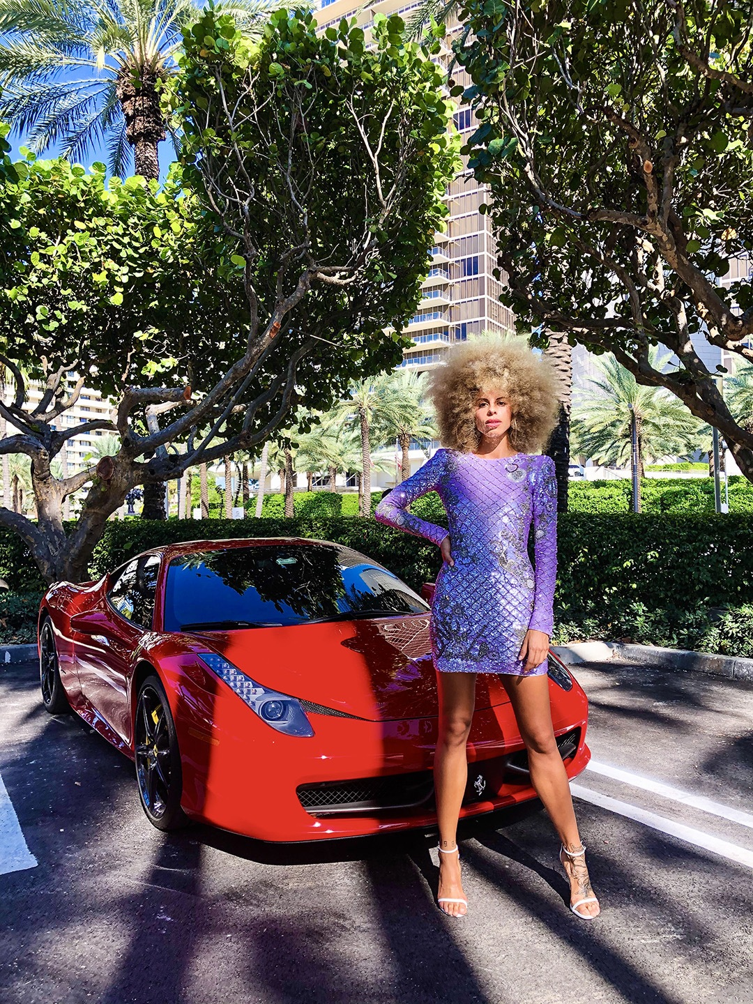Balmain model in front of red Ferrari
