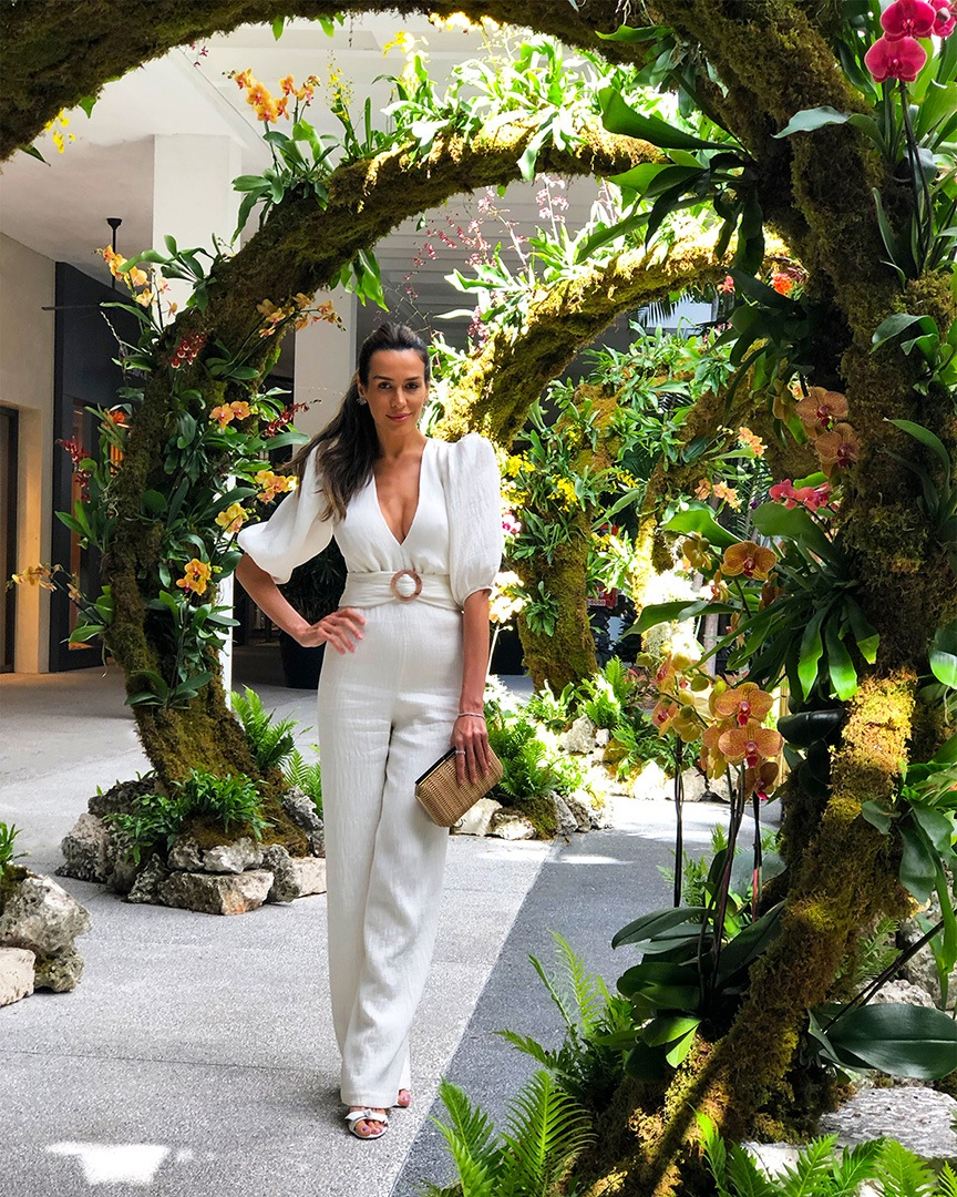 Brazilian model, television reporter, host and Bal Harbour Shops friend Carol Scaff inside one of the 8 circular floral 'Moongates' structures