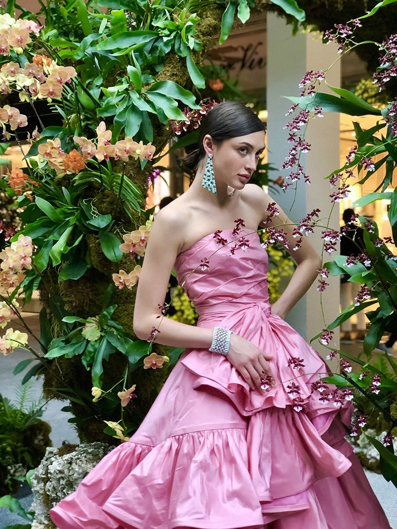 Model Alina Kozyrka in an Oscar de la Renta runway gown and Graff jewels poses under our 'Moongates' tunnels.