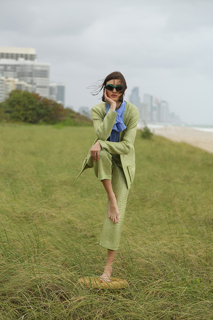 Gucci silk chiffon ruffle blouse, green knit jacket and cropped pant and Stella McCartney sunglasses