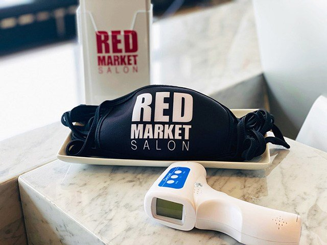 Red Market's safety precautions include a custom mask and thermometer check upon entering.