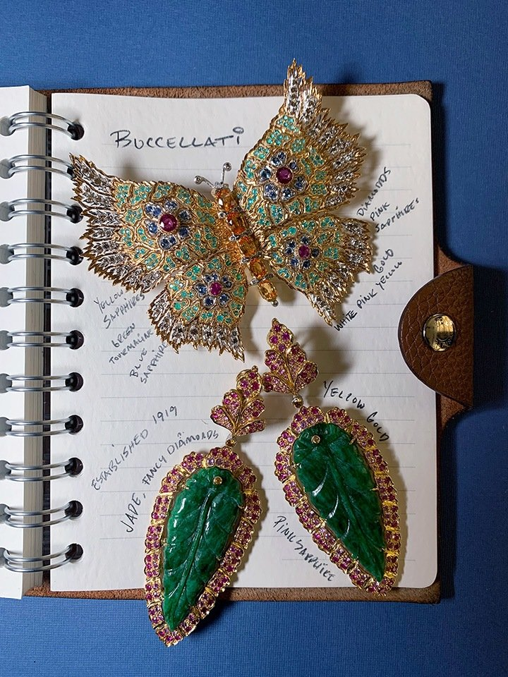 Buccellati's butterfly brooch with pink, blue and yellow sapphires, tourmaline and diamonds; pink sapphire and jade earrings.