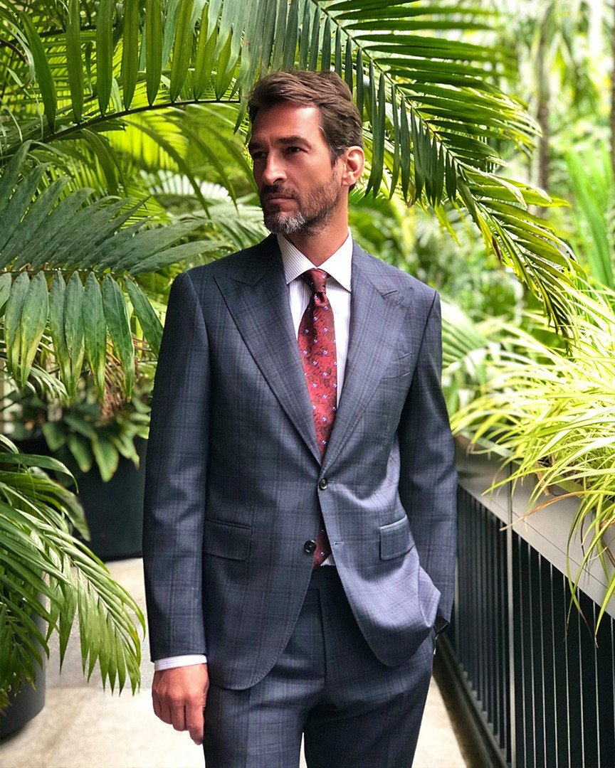 Canali Dandy suit, lilac stripe dress shirt and silk mini purple flower-patterned red tie.