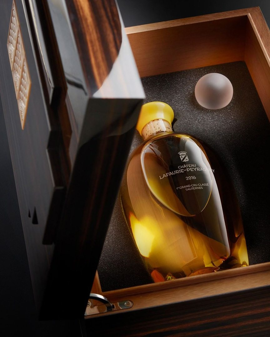 Lalique limited edition Château Lafaurie-Peyraguey bottle and precious wood case.