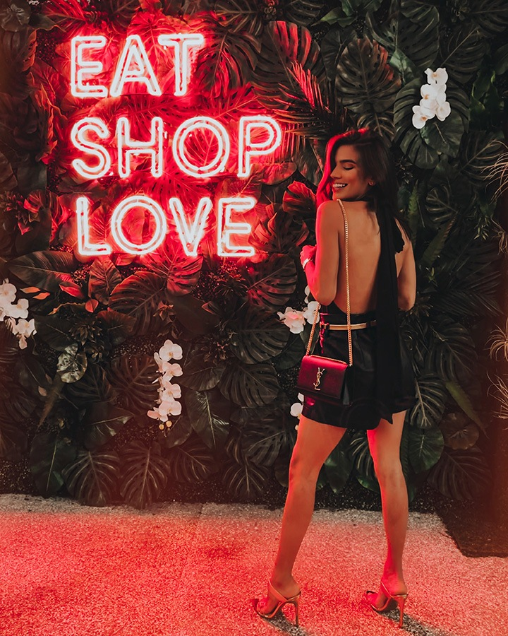 Carla Nuñez at our EAT SHOPS LOVE Instagrammable Wall Installation on Level 3 of Bal Harbour Shops.