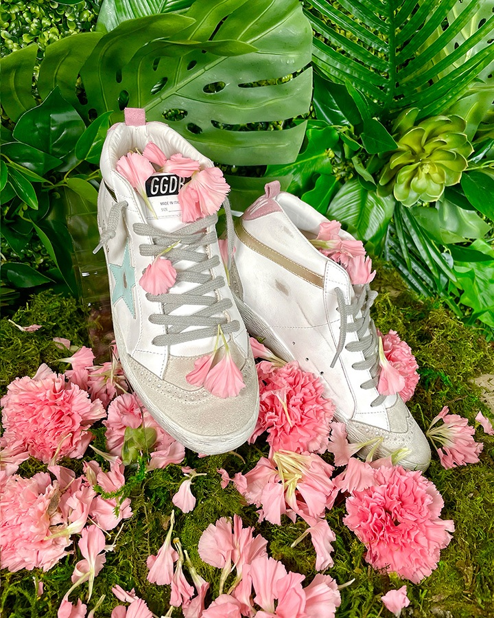 """Golden Goose Mid Star sneakers with """"Love is everything"""" lettering available at Golden Goose Bal Harbour."""