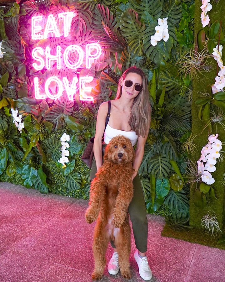 Melissa Marrero at our EAT SHOPS LOVE Instagrammable Wall Installation on Level 3 of Bal Harbour Shops.