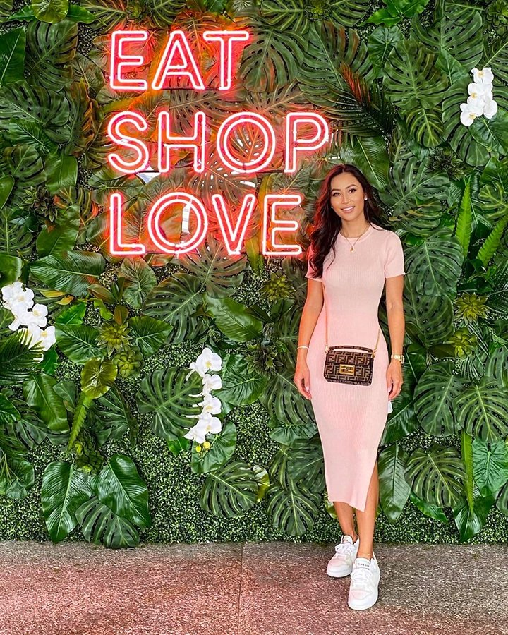 Tina Stuck at our EAT SHOPS LOVE Instagrammable Wall Installation on Level 3 of Bal Harbour Shops.