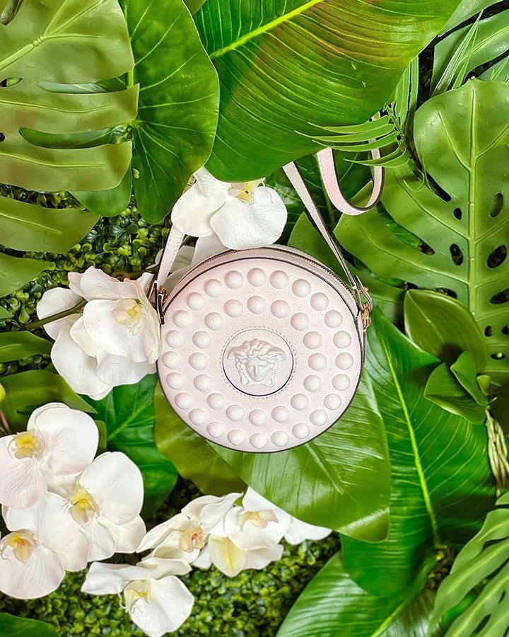 Versace's La Medusa Studded Round Camera Bag in white leather.