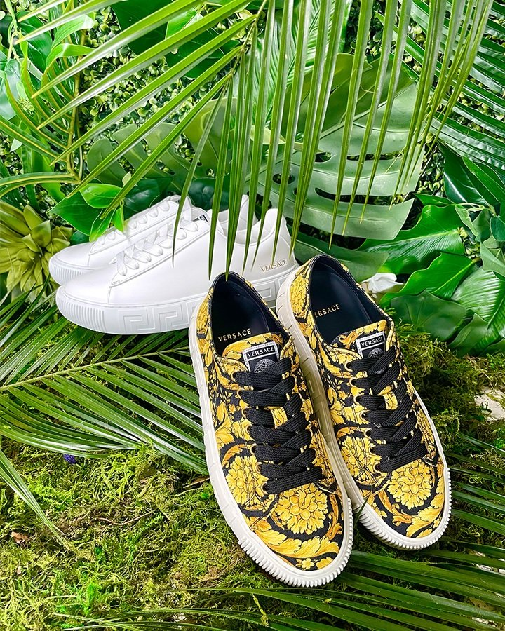 Versace Greca Barocco print sneakers (in black and white) available at Versace Bal Harbour.