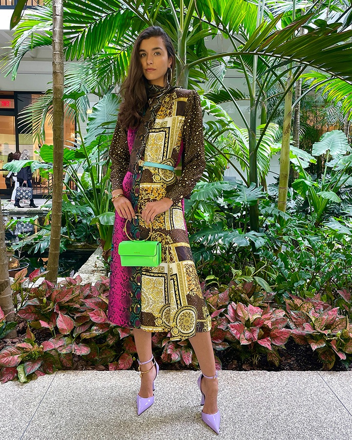 Versace Mixed print silk midi dress, blue Palazzo Dia crystal leather belt, green Medusa Aeternitas Naplak evening bag, thick gold bangle bracelet, gold Grecca hoop earrings and silver Medus Aeternitas choker necklace from the SS21 collection.