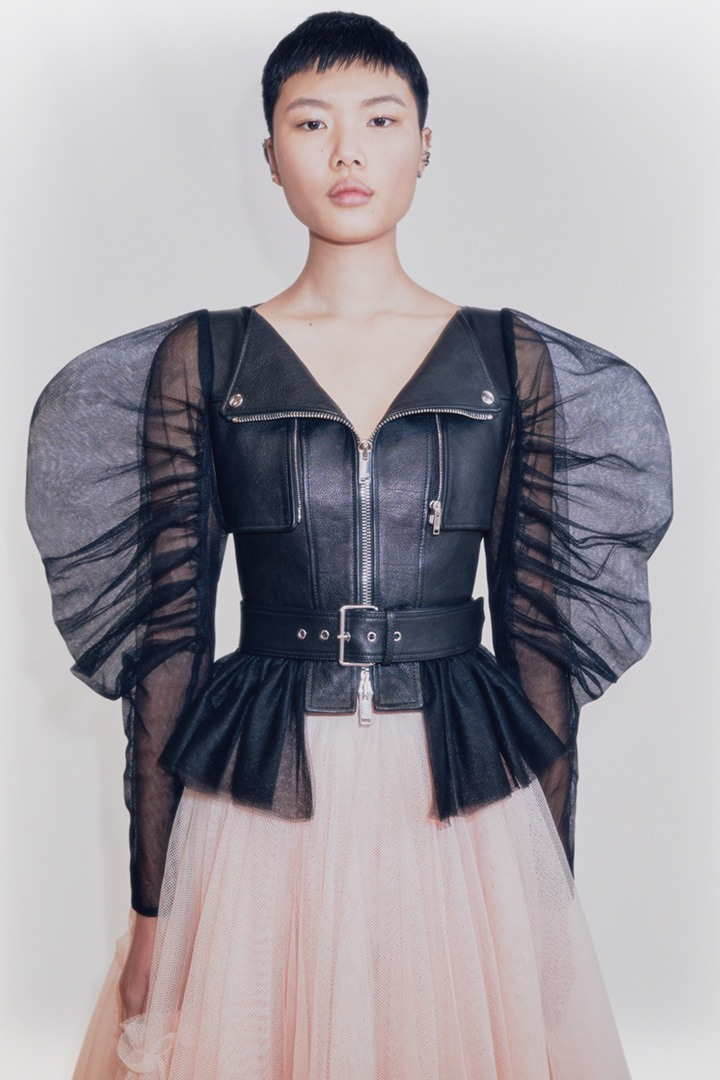 Alexander McQueen black buffalo leather biker jacket with puff tulle sleeves, boat neckline and chest zip pockets.