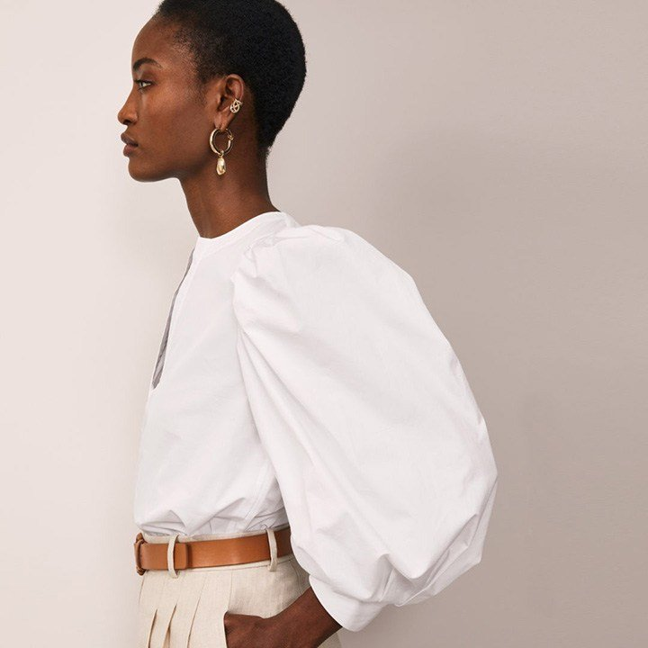 Lafayette 148 white cotton blouse with puffed sleeves and plunged neck detailing.
