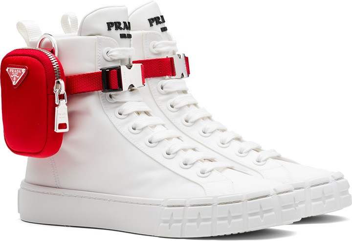 Prada Wheel Re-Nylon Gabardine high-top sneakers with red Prada pouch ankle accent.
