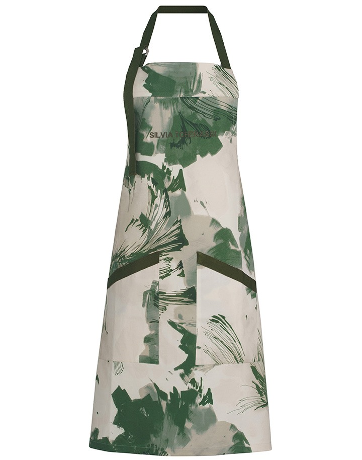Green leaf water color brush stroke apron with Silvia Tcherassi logo and front pockets.