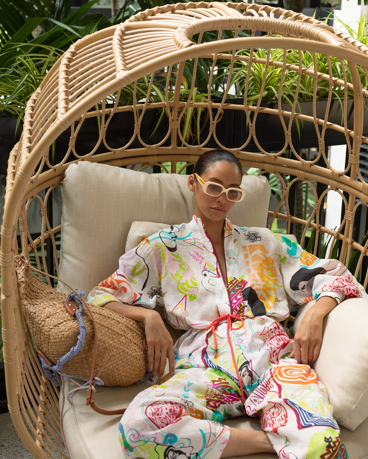 Zimmermann Shelly zip boiler suit styled with Zimmermann sunglasses and macrame basket bag.