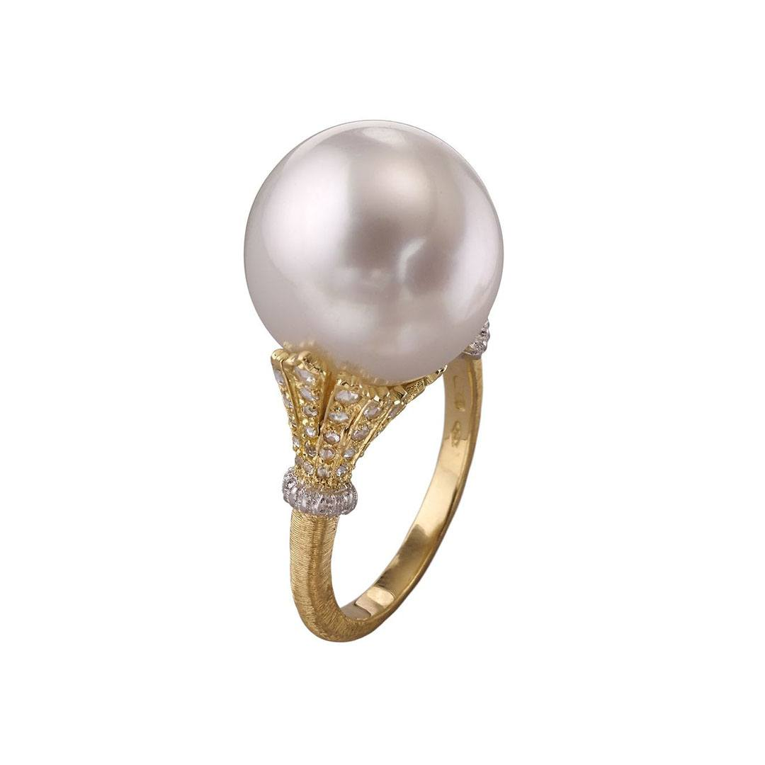 Buccellati Rolo Bolero ring with a South Sea cultured pearl set in gold with diamond pave detailing.