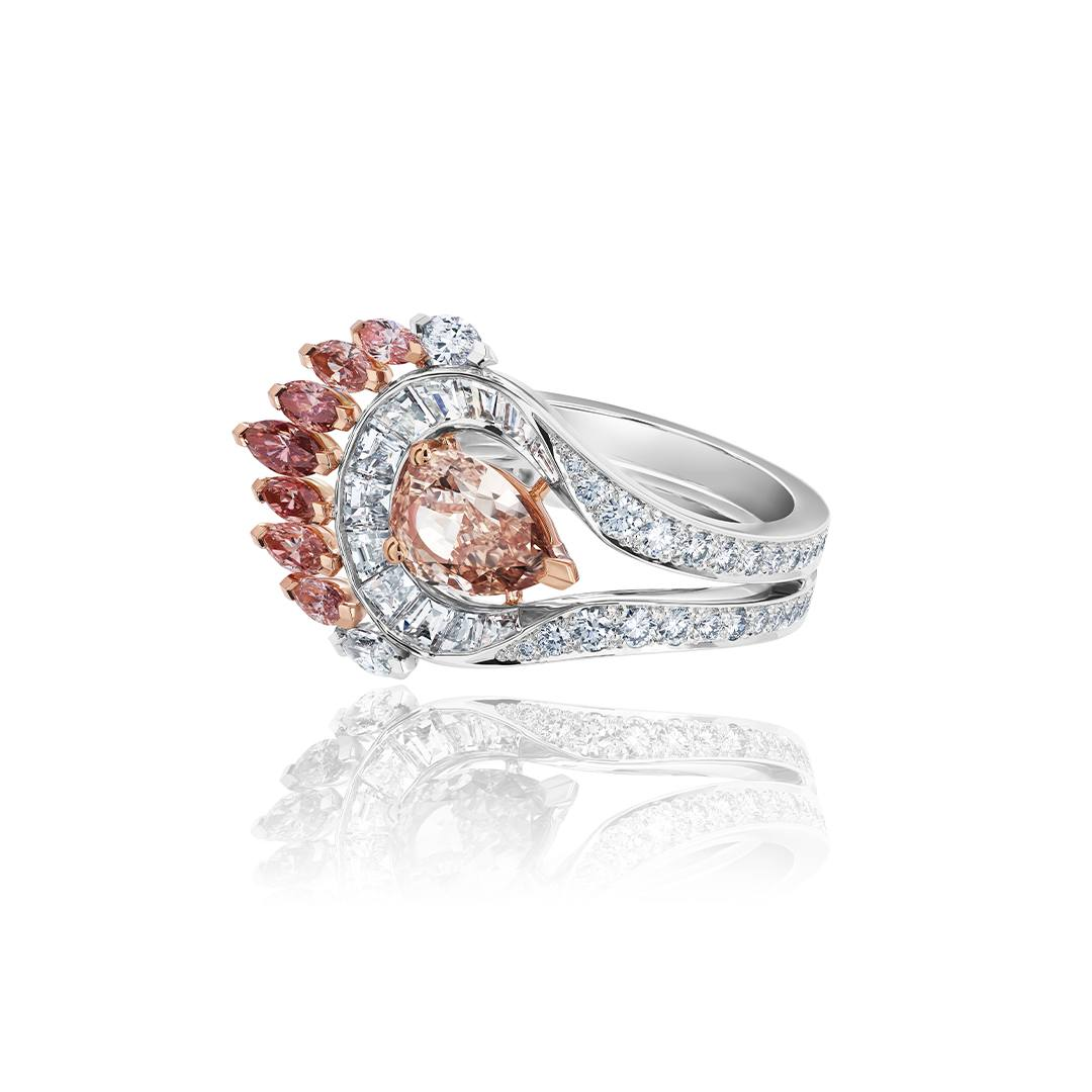De Beers Portraits of Nature Greater Flamingo ring with a 1.55-carat fancy brown orange pear-shaped center diamond, surrounded by white baguette diamonds and nine marquise-shaped white and fancy cut diamonds.