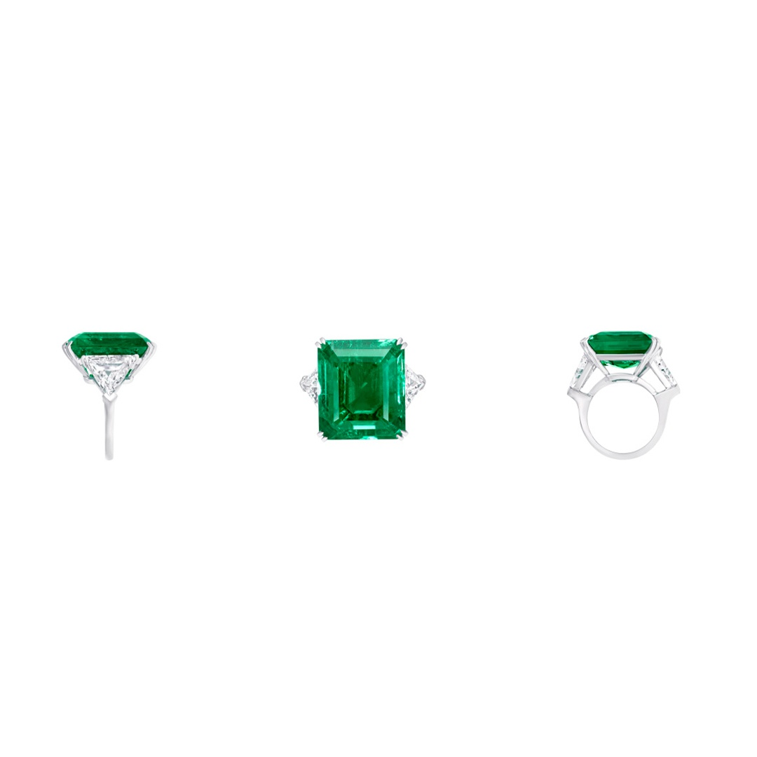 Graff cocktail ring with a 21.07-carat emerald-cut emerald center stone, flanked by 3.82 carats of diamond shoulders.