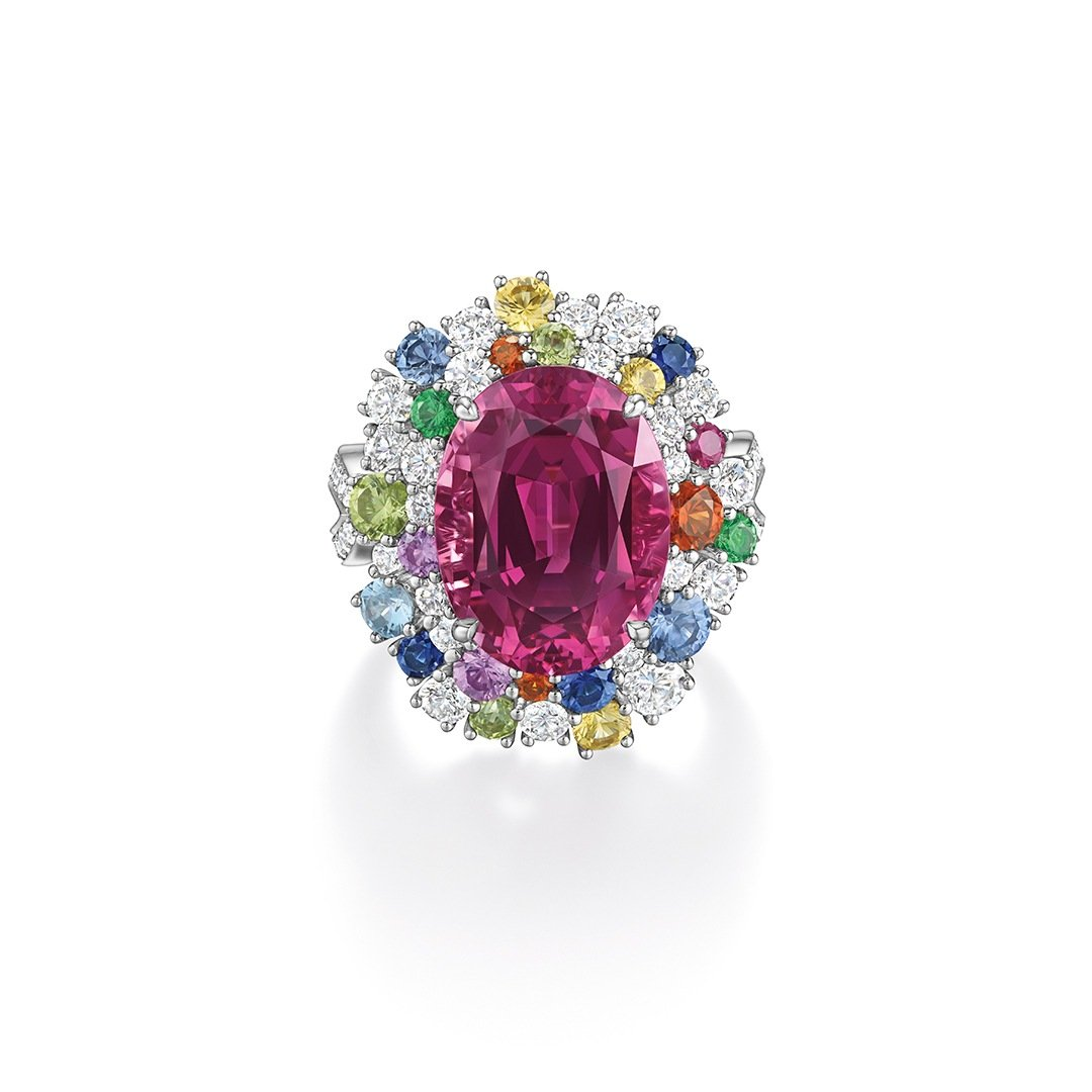 Harry Winston Candy pink spinel cocktail ring with aquamarines, blue, pink and yellow sapphires, peridot, tsavorite, spessartite garnet and diamonds.