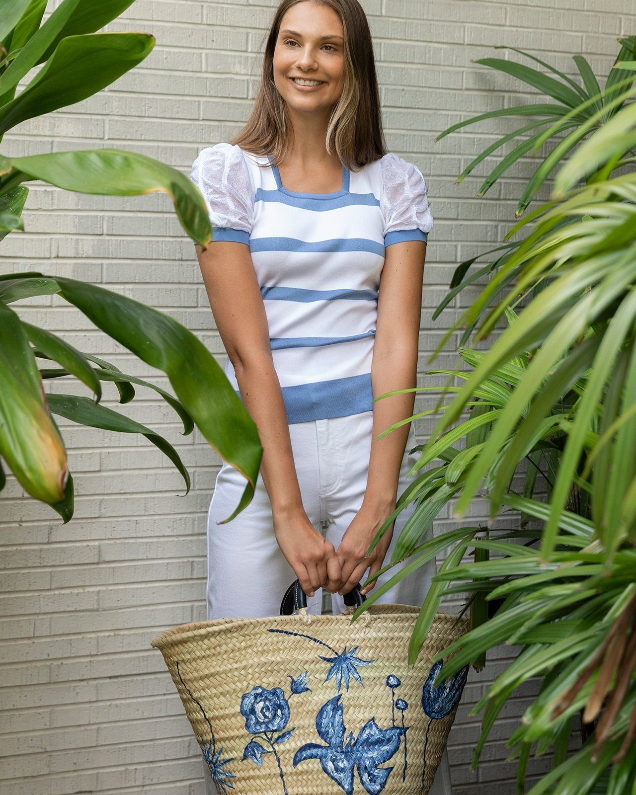 Ralph Lauren blue and white puffed-sleeved top, white pants and straw bag